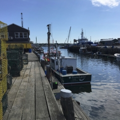 Fishing boats and lobster traps on a Wharf